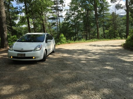 2006 White Toyota Prius on a gravel road